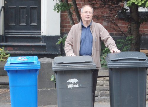 Bernard Little with Blue and Black Bins