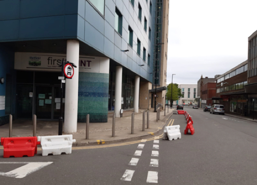 Photo of the temporary footpath widening in town
