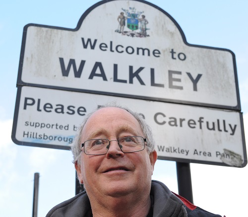 Bernard Little in front of a Welcome to Walkley sign
